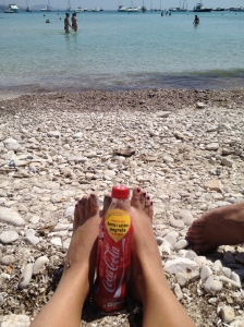 Our feet in the sand and stones..... and my Coke!