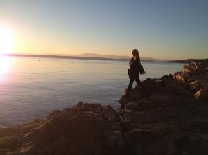 Climbing rocks along the seashore