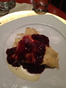 Palecinka stuffed with ice cream and topped with berries and vanilla sauce