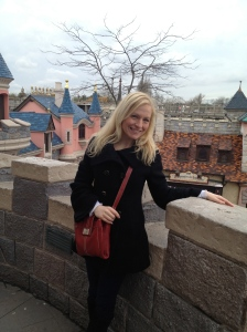Posing on the balcony of the castle, overlooking Fantasyland