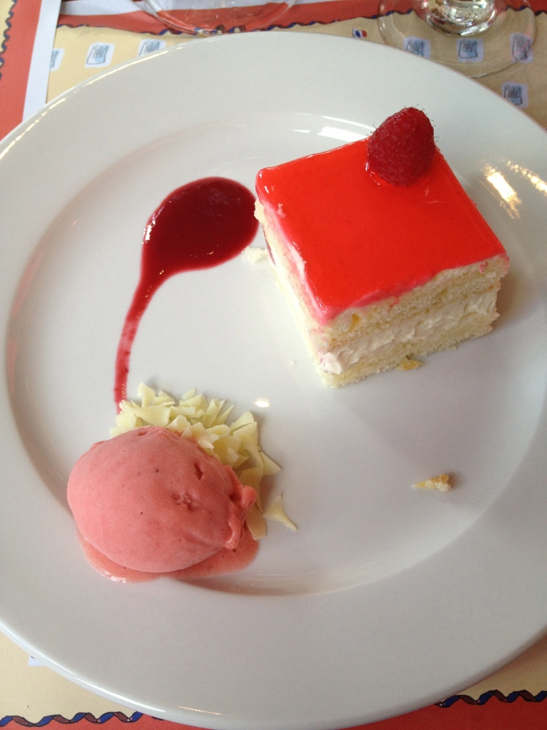 Delicious strawberry cream cake served with raspberry sorbet....mmmm....