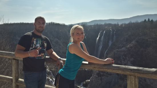 Jen and Miloš posing in front of the Great Falls