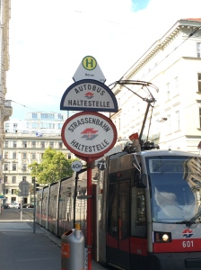 Photo of a tram and bus stop.