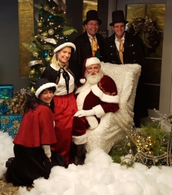 We provided Santa and Carolers for Daylesford Crossing!