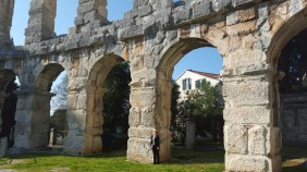 To show the size - Jen standing next to the arches